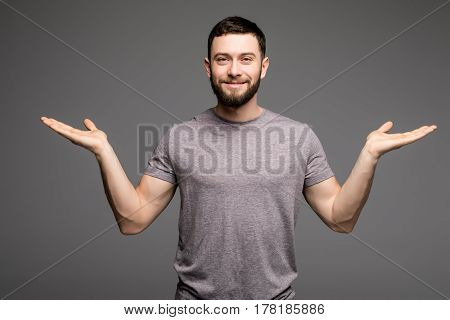 Portrait Of A Smart Serious Young Man In Casual Clothes Standing