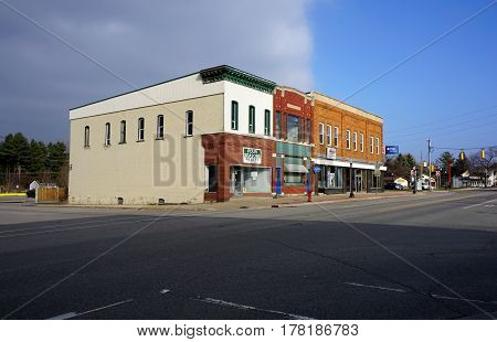 MANCELONA, MICHIGAN / UNITED STATES - NOVEMBER 27, 2016: A city block of commercial buildings in downtown Mancelona.