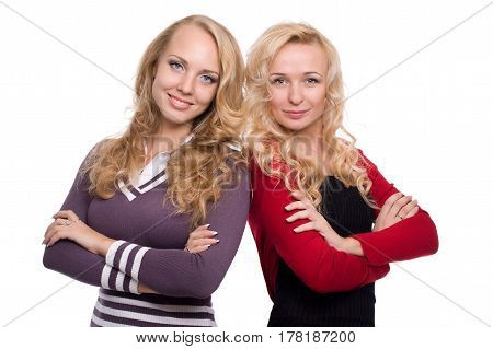two beautiful blond woman sisters with styled blond hair