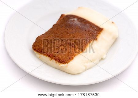 Kazandibi (surface burnt pudding) on white background front view
