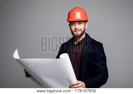 Portrait Of An Architect Builder Studying Layout Plan Of The Rooms, Serious Civil Engineer Working W