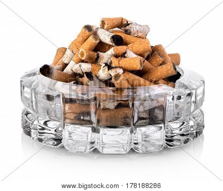 Butts in a glass ashtray isolated on white