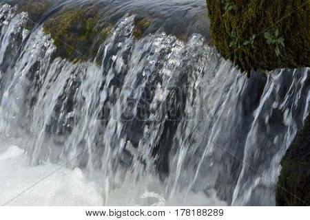 Detail of Cascade with rocks and moss