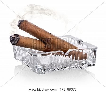 Cigars and ashtray isolated on a white background