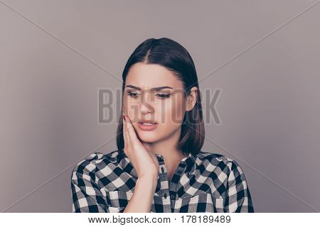 A Horizontal Photo Of A Young Worried Woman In Checkered Shirt Suffering From Strong Toothache And T