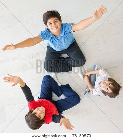 Kids on the floor together in new home top view