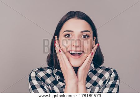 Wow! It's Unbelievable!  A Close Up Portrait Of A Young Wondered Woman With Opened Mouth Touching He