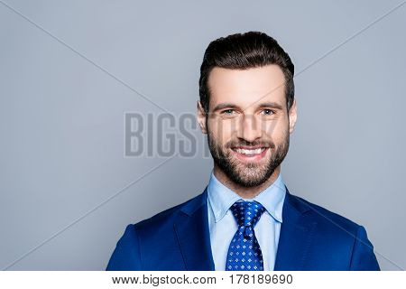Portrait Of Serious Fashionable Handsome Man In Formal Clothes Smiling