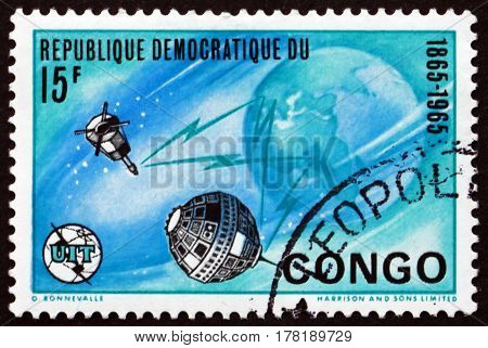 CONGO - CIRCA 1965: a stamp printed in Congo shows Earth and Satellites circa 1965