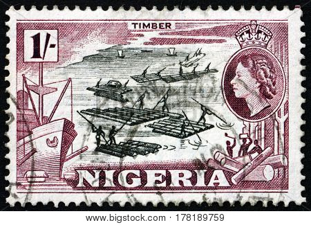 NIGERIA - CIRCA 1953: a stamp printed in Nigeria shows Logging circa 1953