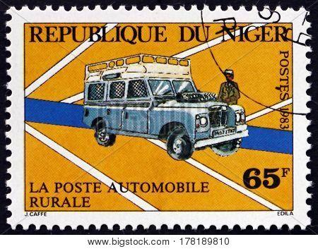 NIGER - CIRCA 1983: a stamp printed in Niger shows Mail Van circa 1983