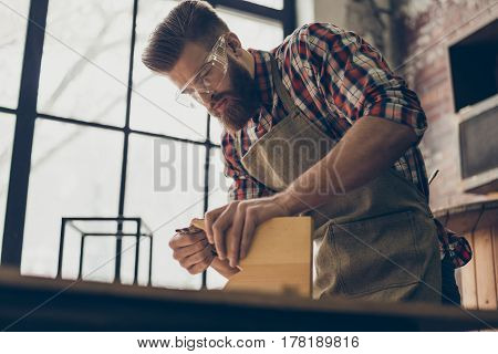 Diligent Stylish Handicraftsman With Safety Glasses Carving A Handmade Piece Of Furniture At His Wok