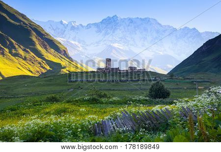 A fascinating view on Ushguli village at the foot of snow-capped Mt. Shkhara. Location place Lamaria Church Jgrag Upper Svaneti Georgia Europe. Happy lifestyle. Beautiful universe.