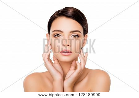 Portrait Of Young Pretty Lady With Perfect Skin Gently Touching Her Face