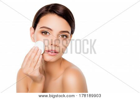 An Image Of Young Beautiful Woman On Isolated White Background Using Cotton Pad For Removing Makeup