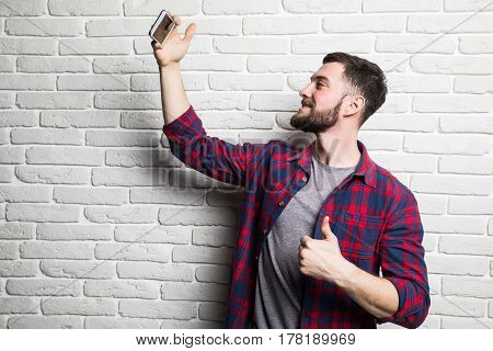 Beautiful Young Man In Casual Clothes Make Selfie
