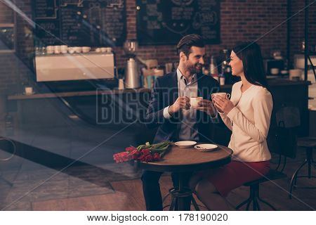 Happy Romantic Couple Dating In A Cafe Drinking Coffee