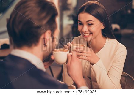Happy Romantic Couple Sitting In A Cafe With Coffee