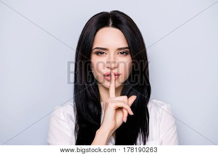 Shh! Portrait Of Young Pretty Woman Asking To Make Silence. She Touch Lips With Finger