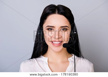 Portrait Of Young Consultant Of Call Center In Headphones Isolated On Gray Background