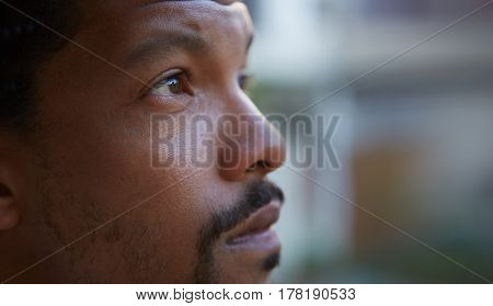 Close up portrait of a serius young bearded black guy.
