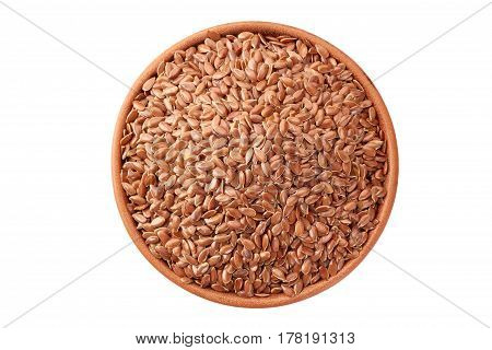 Linseeds in ceramic bowl isolated on white background. Top view