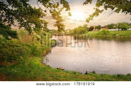 Beautiful sunset over lake near a village