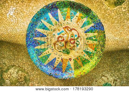 BARCELONA, SPAIN - OCTOBER 27, 2008: Ceiling with a sun mosaic at the Parc Guell designed by Antoni Gaudi, Barcelona, Spain.