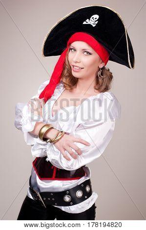 Beautiful woman in carnival costume. Pirate shape.