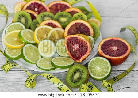 A Variety Of Fruits And Measuring Tape