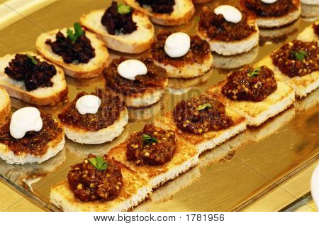Tapanade On Crostini  Caviar On Freshly Baked Eggplant Fig Canapes With Cream Cheese