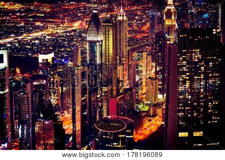 downtown dubai at night with illuminated streets and buildings