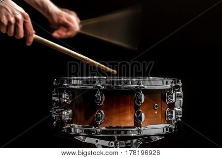 Man Plays Musical Percussion Instrument With Sticks A Musical Concept With The Working Drum