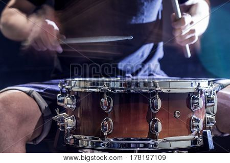 Man Plays Musical Percussion Instrument With Sticks, A Musical Concept, Beautiful Lighting On The St