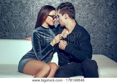 Young passionate couple close together on sofa