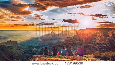 Friends watching the sunset at Grand Canyon National Park