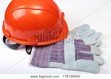 Orange earplug , hard hat, safety glasses, gloves. Earplug to reduce noise on a white background. you can place your text