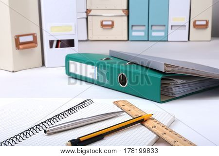 Folder file, pen, pencil and note on the desk. blurred background