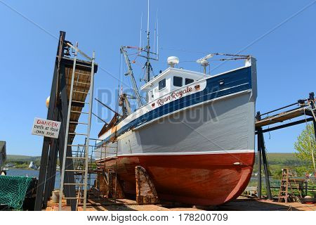ANNAPOLIS ROYAL, NS, CANADA - MAY 21, 2016: Historic Fishing Boat Ryan Royale in Annapolis Royal, Nova Scotia, Canada. The historic core of Annapolis Royal was designated a National Historic Site of Canada in 1994.