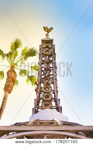 Hollywood against the blue sky the sun and palm trees. Los Angeles.  View Up; vertical.