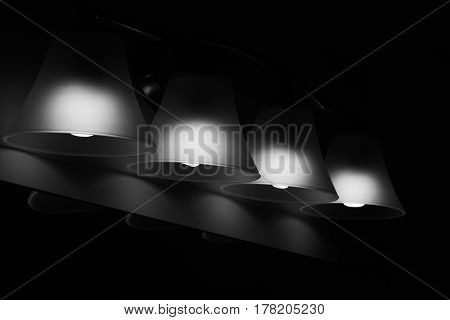 Photo of a four light fixture in Monochrome