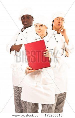 Studio shot of multi-ethnic group of cooks holding menu