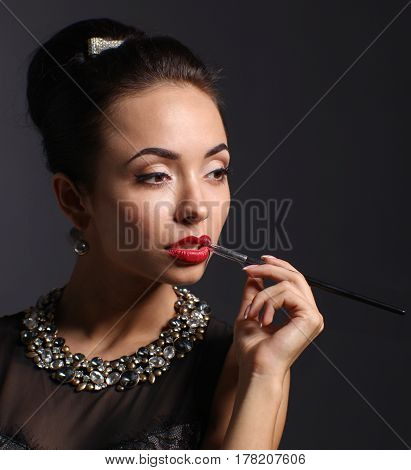 Portrait of young beautiful woman with jewelry .
