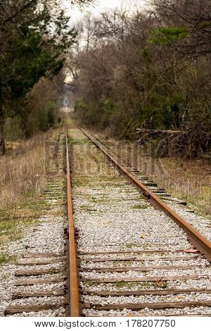 Unused Railroad Tracks Stretching into the Distance