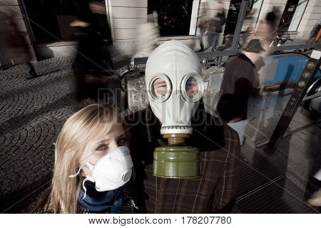 young people in town, wearing a flu protection mask and a gas mask