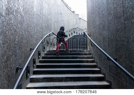 Man Climbs The Stairs. Stairs Up.