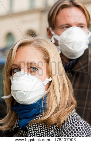 young people in town, wearing flu protection masks