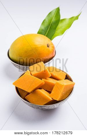 Indian sweet - traditional mango burfi or cake or bar made up of authentic alphonso or hapus mangos from konkan, india