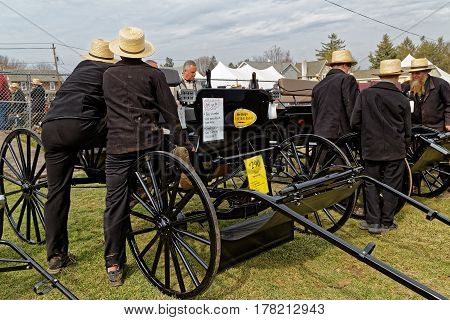 GAP PENNSYLVANIA - MARCH 25 2017: Amish men looking at new and used carriages at the annual