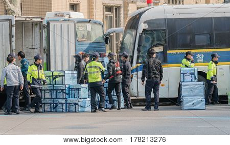 SEOUL South Korea March 18 2017:Police in central Seoul take delivery of food for riot police on duty at anti-impeachment rally